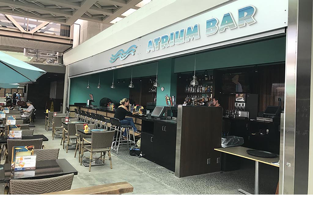 Atrium Bar Features locally brewed microbrews from various islands. Guests can quench their thirst by indulging  in the sophisticated tastes of the exotic Hawaiian islands in a comfortable and relaxing environment. </br> Open daily 10:00 am - 6:00 pm