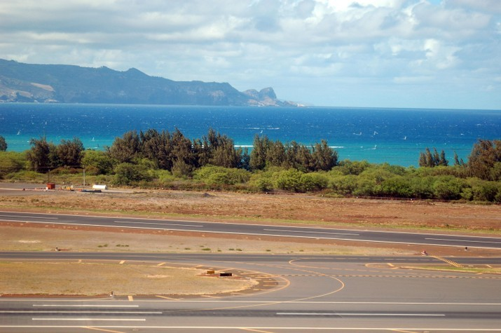 View of Maui's northwest shore from one of Kahului Airport's runway.